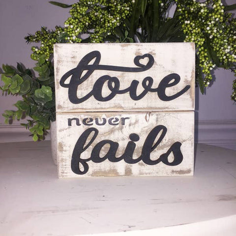 Love Never Fails Slatted Wooden Sign