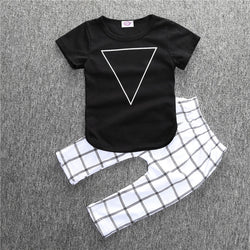 Black Triangle top and checkered white pants