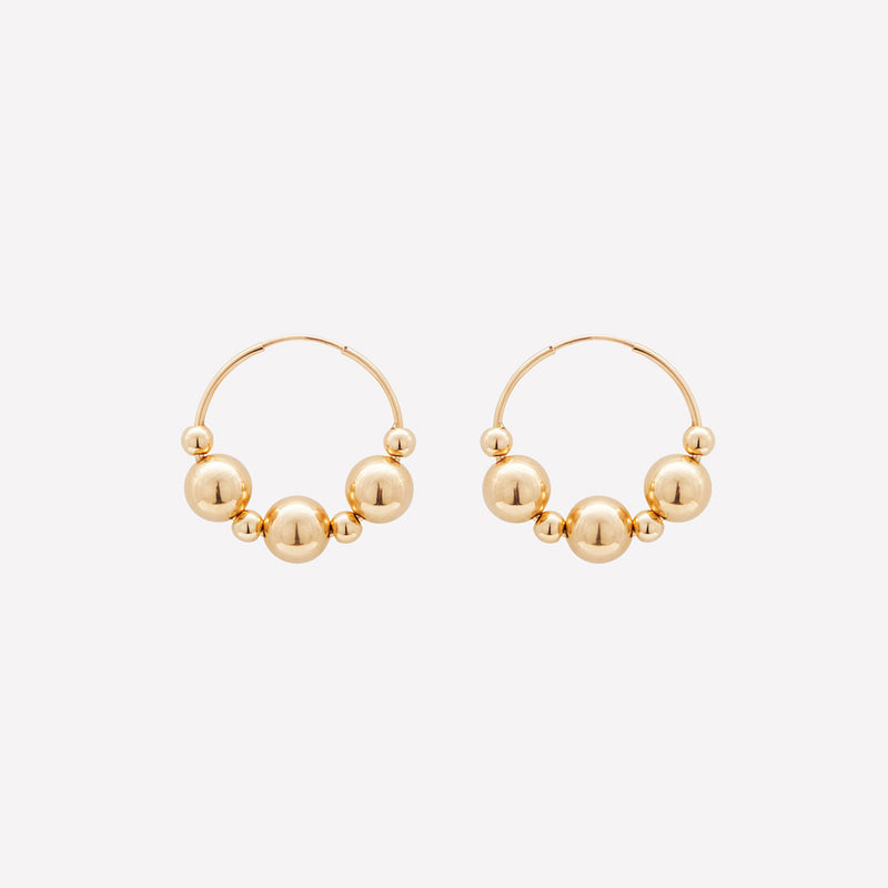 Yellow gold medium hoop earrings with gold beads for women