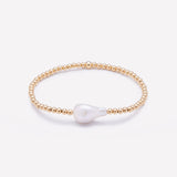 Yellow gold beaded bracelet with baroque pearl for women