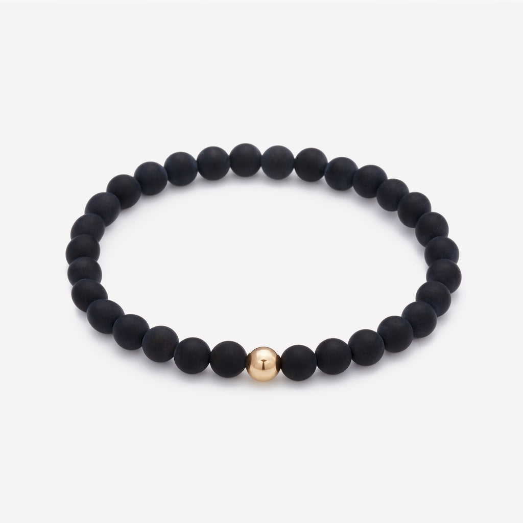 Matte onyx beaded bracelet with yellow gold bead for men