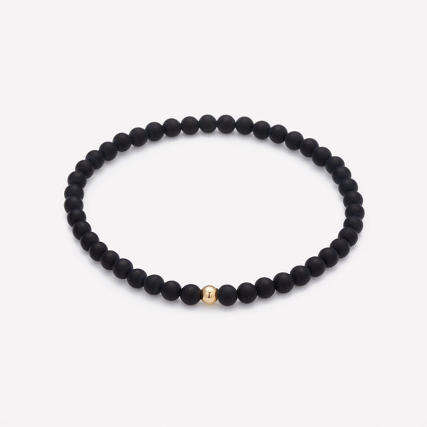 Matte onyx beaded bracelet with single yellow gold bead for men