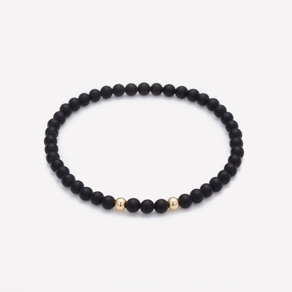 Matte onyx beaded bracelet with double yellow gold beads for men