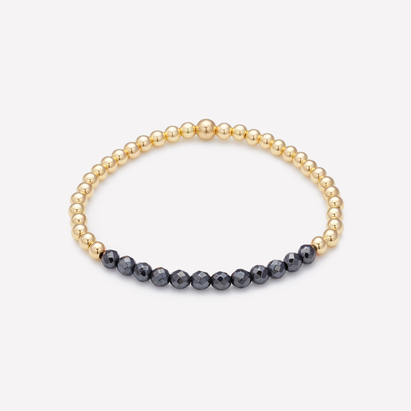 Yellow gold beaded bracelet with hematite row for women