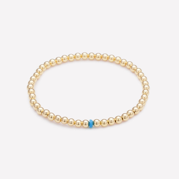 Yellow gold beaded anklet with single turquoise crystal for kids