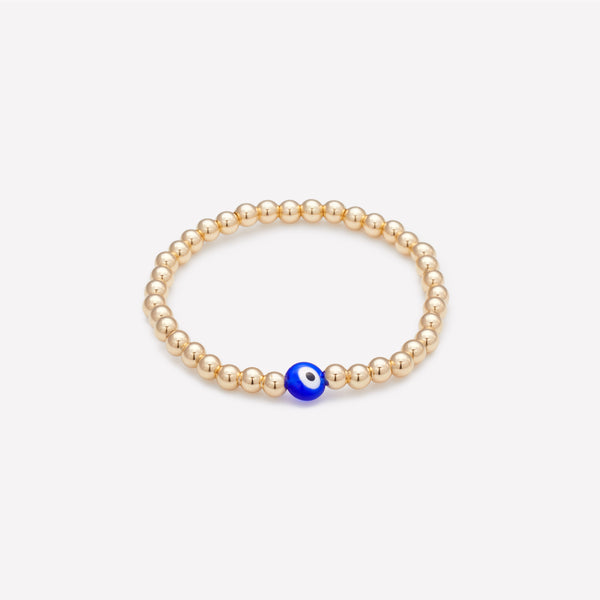 Yellow gold beaded bracelet with blue glass evil eye as seen in vanity fair for kids