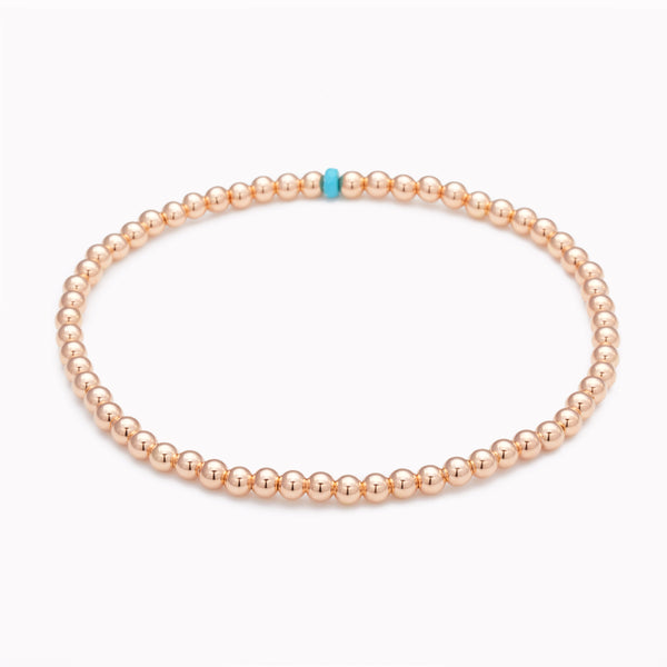 Rose gold beaded anklet with single turquoise crystal for women