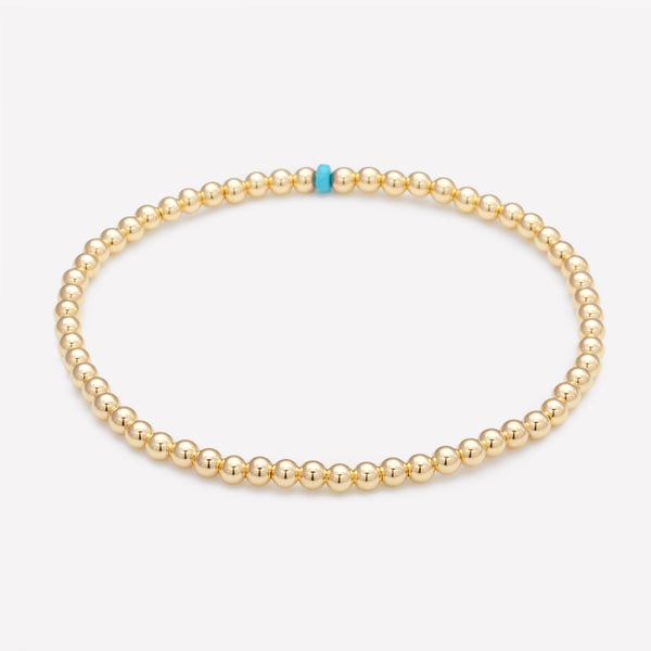 Yellow gold beaded anklet with single turquoise crystal for women