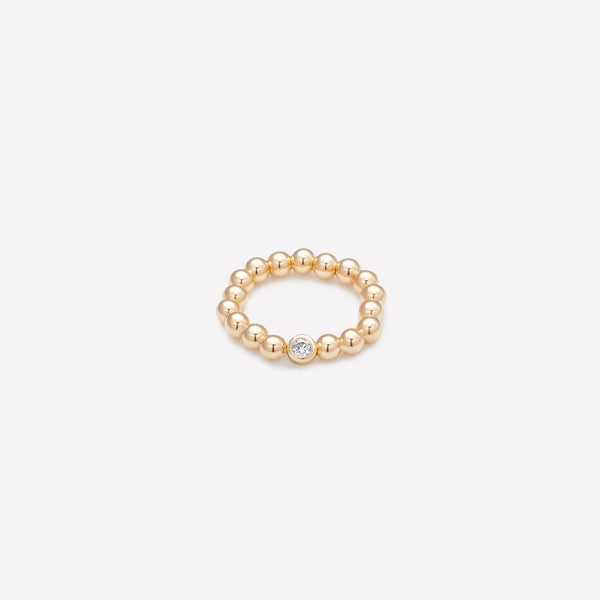 Yellow gold beaded bracelet with single gold plated Zirconia for women