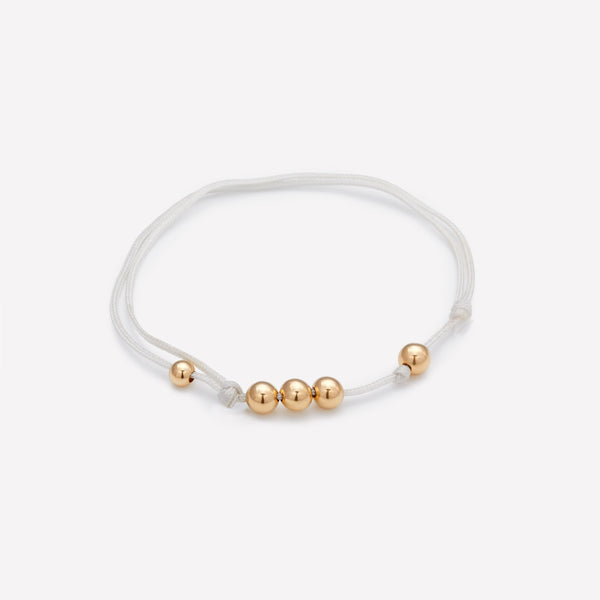 Grey silk string bracelet with yellow gold beads for men and women