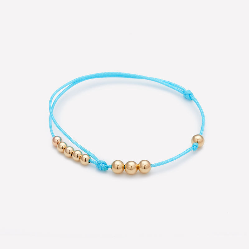 Turquoise silk string bracelet with yellow gold beads for men and women