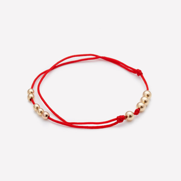 Red silk string bracelet with yellow gold beads for men and women