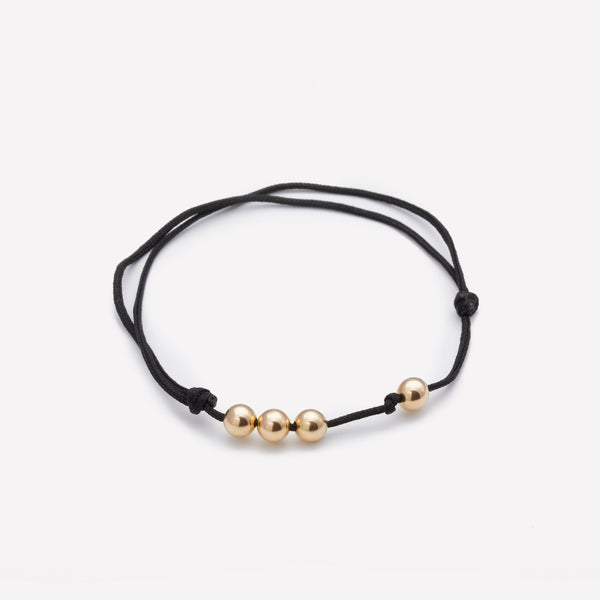 Black string bracelet with yellow gold beads for men and women