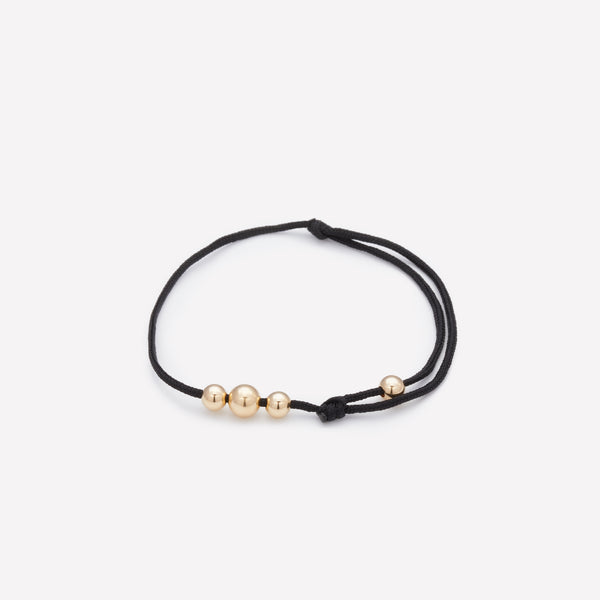 Black string bracelet with yellow gold beads for kids