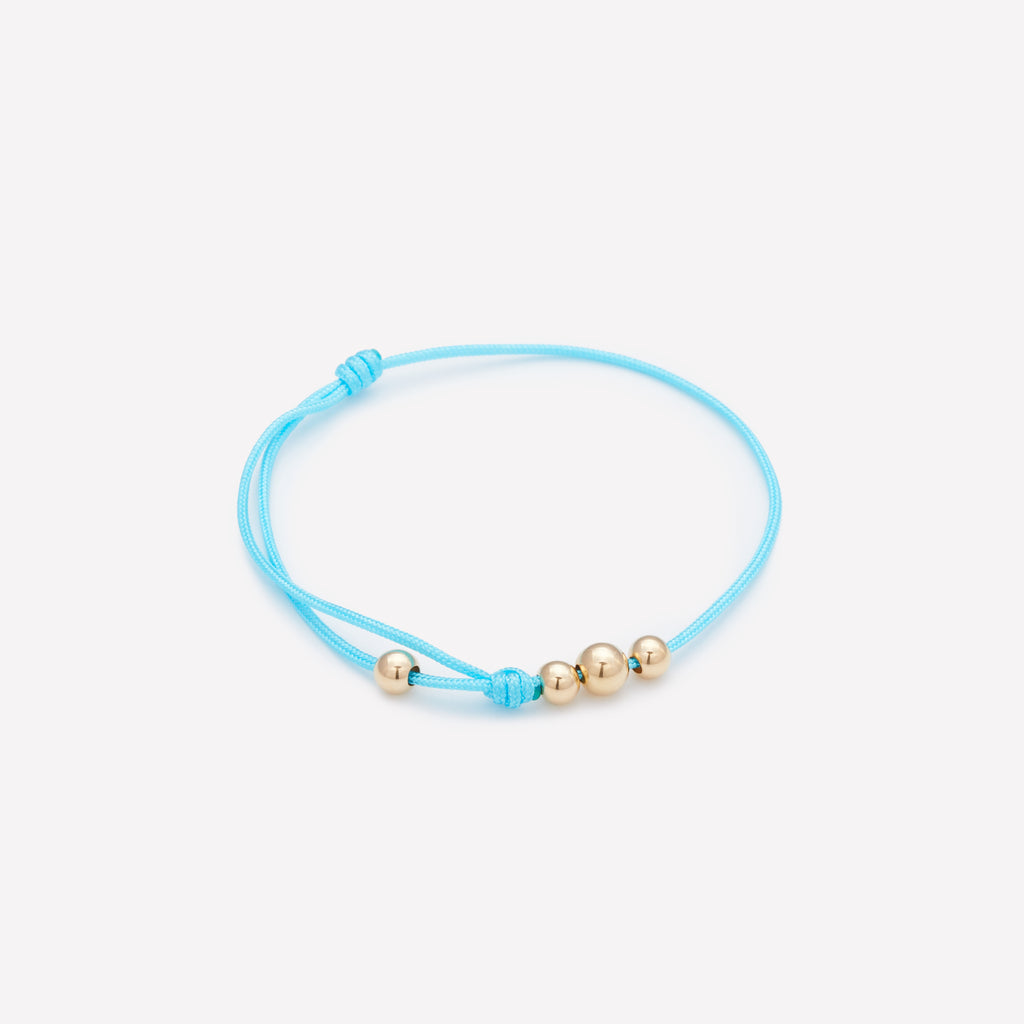 Turquoise string bracelet with yellow gold beads for kids