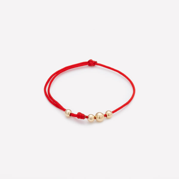 Red string bracelet with yellow gold beads for kids