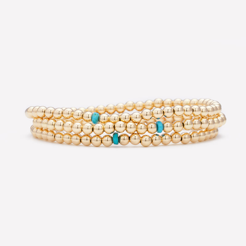 Yellow gold beaded anklet with single turquoise crystal stack for women
