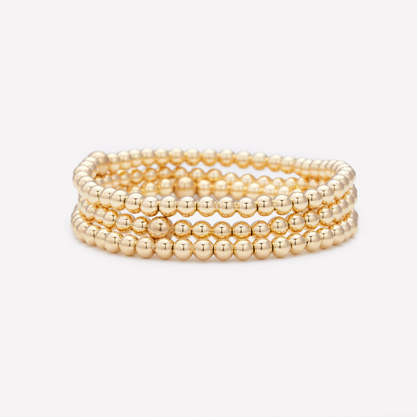 Yellow gold beaded bracelet stack for women