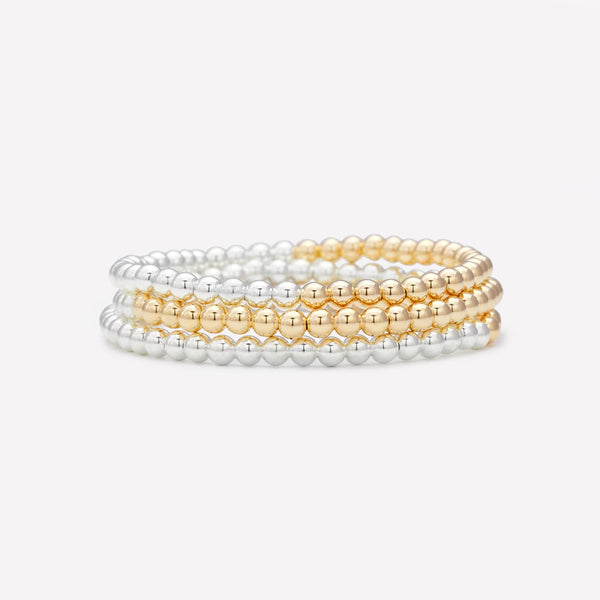 Two tone silver and yellow gold bracelet stack for women