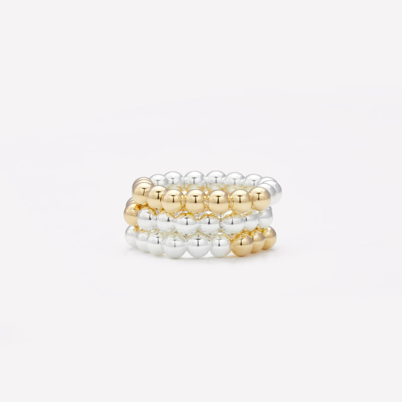 Two tone silver and yellow gold ring stack for women