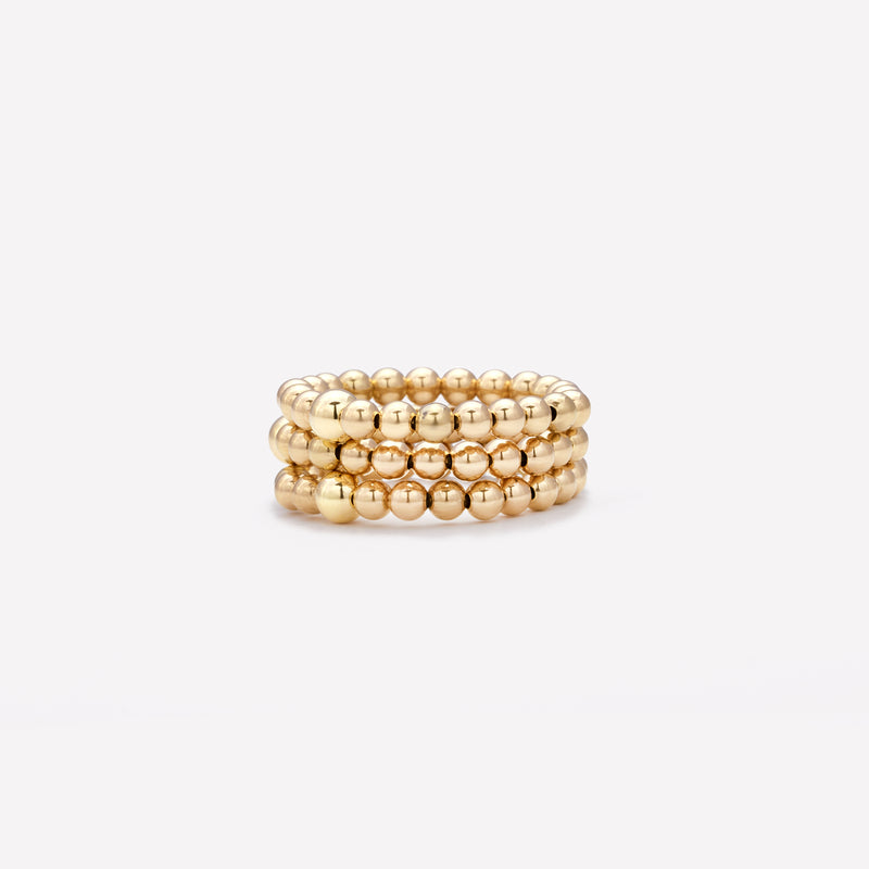 Yellow gold beaded ring stack for women