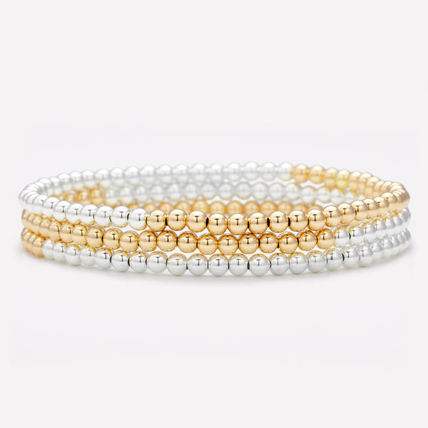 Two tone silver and yellow gold anklet stack for women