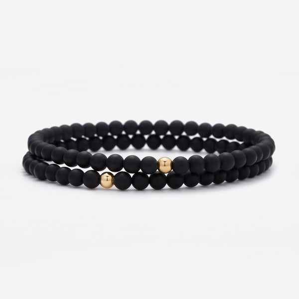 Matte onyx beaded bracelet with single yellow gold bead stack for men