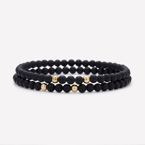 Matte onyx beaded bracelet with double yellow gold beads stack for men