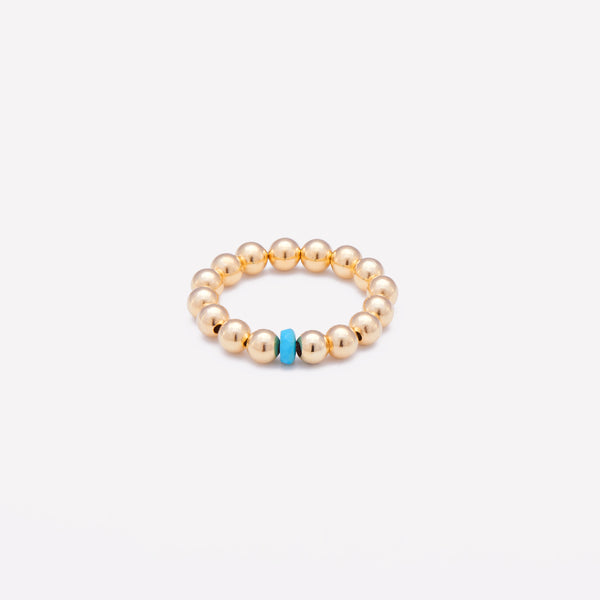 Yellow gold beaded ring with single turquoise nugget for women