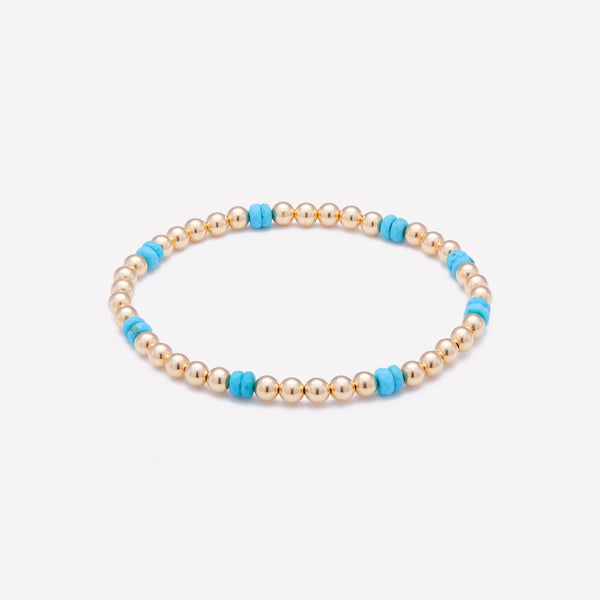 Yellow gold beaded bracelet with turquoise nuggets for women