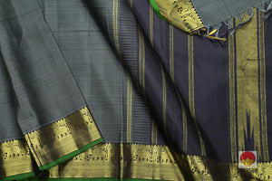 body, border and pallu of black and blue self striped kanjivaram pure silk saree
