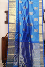 Drape of body and pallu of blue traditional design kanjivaram silk saree