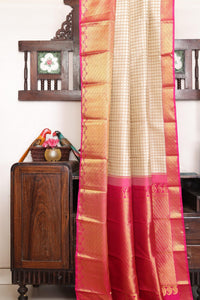 Drape of body and pallu of beige kanjivaram silk saree