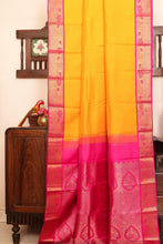 Drape of body and pallu of yellow kanjivaram silk saree
