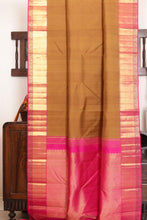 Drape of body and pallu of mustard kanjivaram silk saree