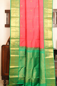 Drape of body and pallu of peach traditional design kanjivaram silk saree