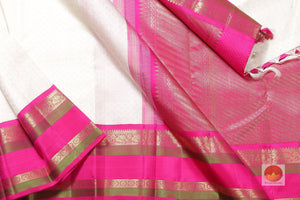 body, border and pallu of white kanjivaram pure silk saree