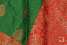 fabric detail of silk yarn in green banarasi matka silk saree