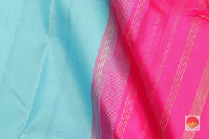 fabric detail of silk yarn in blue temple border kanjivaram saree