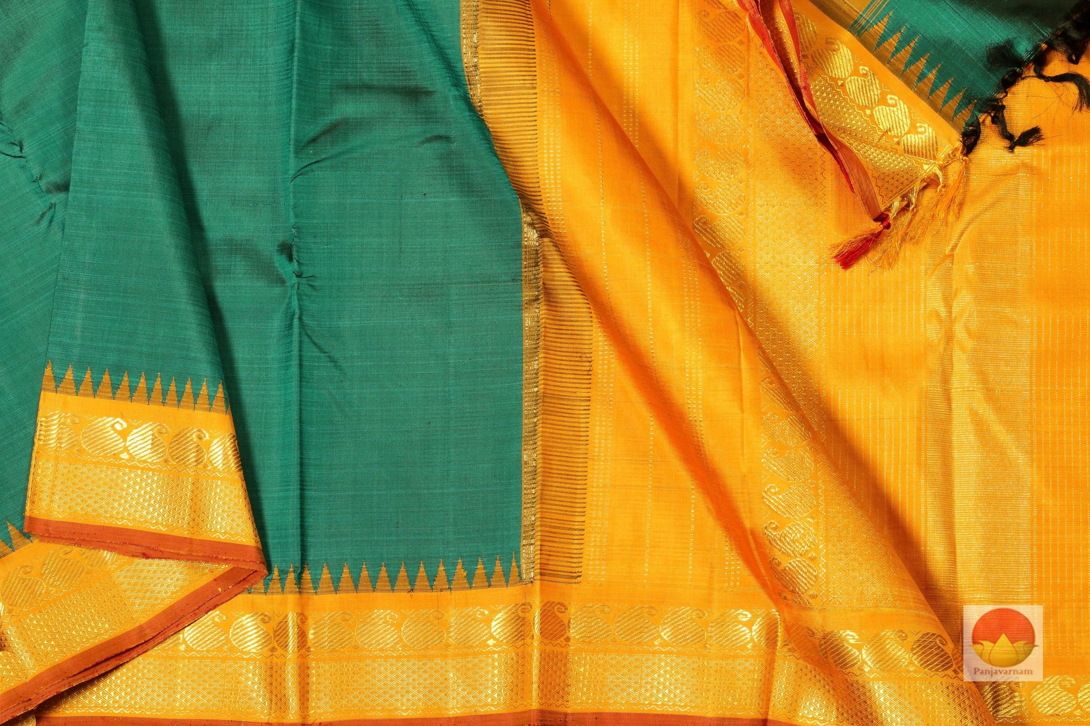 body, border and pallu of emerald green kanjivaram silk saree