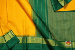 body, border and pallu of yellow kanjivaram pure silk saree
