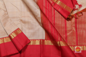 body, border and pallu of beige and red  kanjivaram pure silk saree