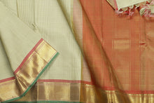 body and border detail of off white  kanjivaram silk saree