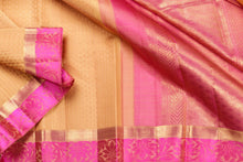 Drape of yellow and pink pure silk kanjivaram saree