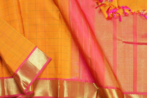 body and border detail of yellow  kanjivaram silk saree