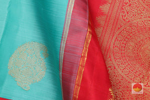 fabric detail of silk yarn in teal kanjivaram silk saree