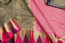 Drape of body and border of tan and pink kanjivaram silk saree