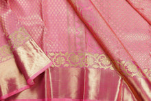 zari detail of  traditional design pink bridal kanjivaram pure silk sari