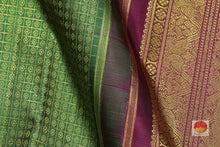 fabric detail of silk yarn in green and maroon kanjivaram silk saree