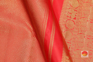 fabric detail of silk yarn in orange traditional kanjivaram silk saree